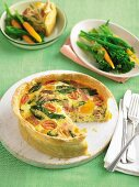 Shortcrust pastry quiche filled with bacon, egg, tomatoes and spinach