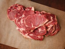 Grass Fed Rib-Eye Steaks on Parchment Paper