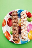 Marshmallow kebabs on a colourful paper plate