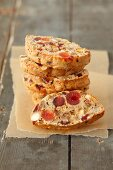 Nut cake with almonds, dried fruit and glacé fruits (sliced)