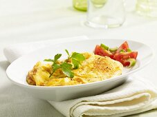 Scrambled egg with a tomato salad