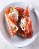 A raw ham, tomato and mozzarella sandwich