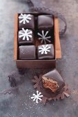 A box of Dominosteine (chocolate covered sweets with marzipan and gingerbread)