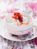 Quark with meringues and strawberries in a bowl