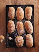 Fresh ciabatta rolls on a baking tray