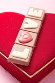 Valentine's Day chocolate on a velvet cushion