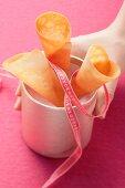 Three ice cream cone in a golden cup