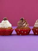 Three cupcakes with various toppings