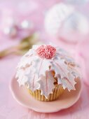 A Christmas cupcake with pink decorations