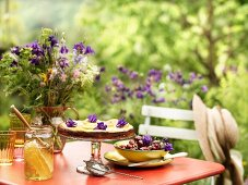 A honey and ricotta tart on a table in the garden