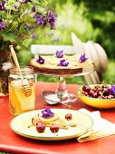 A honey and ricotta tart on a table in a garden