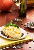Pumpkin risotto with pumpkins seeds and white wine