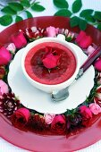 Strawberry mousse decorated with summer flowers
