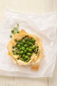 A puff pastry dish filled with peas