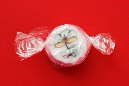 A sugar bonbon in cellophane paper