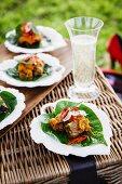 Braised beef with pumpkin on betel leaves