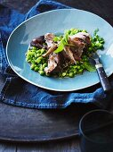 Roast shoulder of lamb with peas and mint