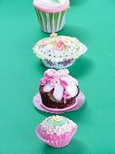 Various cupcakes decorated with flowers