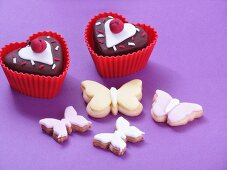 Valentine's Day cupcakes and butterfly biscuits