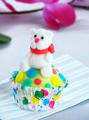 A cupcake decorated with a teddy bear