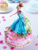 A child's cake decorated with a Barbie