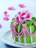 A mini marzipan cake decorated with a rose