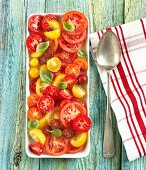 Sliced Heirloom Tomato Salad on a Serving Dish; From Above