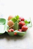 Strawberries and eggs in an eggbox