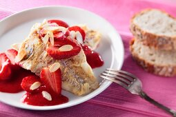 Fried fillet of fish with strawberry sauce