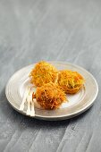 Spheres of goose liver with deep-fried angel hair pasta