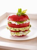 Tomato layered and stuffed with ricotta, anchovy and broad beans