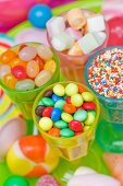 Assorted colourful sweets (jelly sweets, chocolate beans, marshmallows and lollipops)