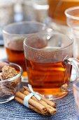 Winter tea, cinnamon sticks and sweets