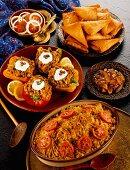 Curries, samosas, stuffed peppers, mango chutney and tomato and onion salad