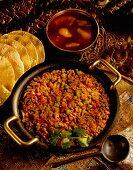 Lamb curry with mango chutney and poppadoms (India)