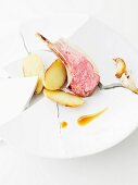Lamb rack joint with potatoes and garlic