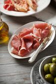Serrano ham, green olives and tomato bread