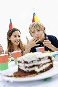 Children eating birthday cake