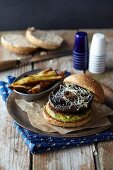 Vegetable burger with courgettes, mushrooms and sweet potato chips