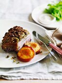 Pistachio-crusted pork with roasted peaches