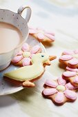 Butter biscuits with icing, with a cup of tea