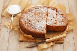 Carrot cake topped with icing sugar