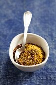 Ground black mustard seeds in a small bowl