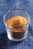Ground nutmeg in a glass