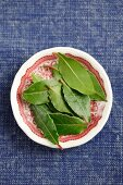 Several fresh bay leaves on a plate
