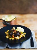 Venison ragout with mashed potato and quince jelly