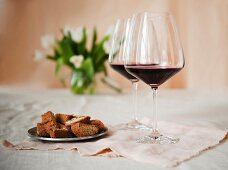 Two Glasses of Bordeaux Wine with a Plate of Biscotti