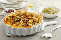 Beef with courgette and potatoes in a filo pastry crust