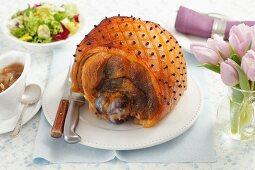 Roast ham on the bone, studded with cloves