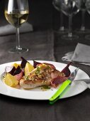 A pork chop with beetroot and turnip
